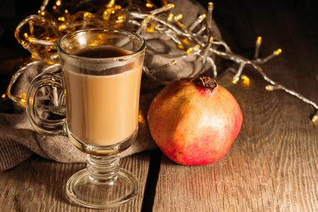 christmas food: Irish coffee and pomegranate selective focus