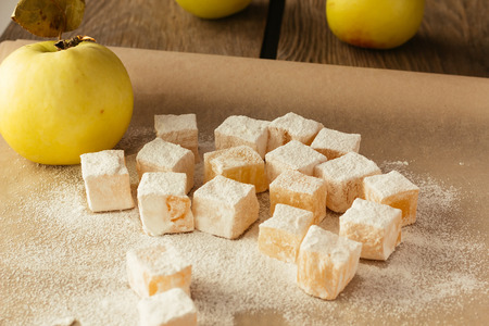 locum: Turkish delight and apple on cooking paper selective focus