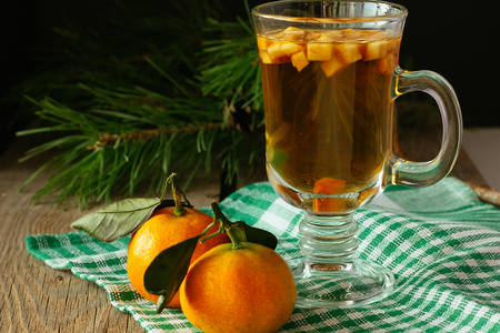 christmas food: Punch with fruits and two tangerines horizontal selective focus