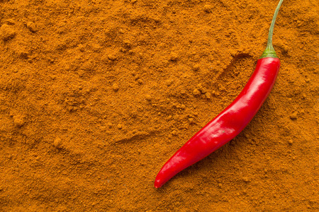 peppery: Chili pepper pod on chili powder top view selective focus