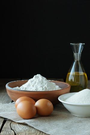 loamy: Flour, eggs, sugar and oil selective focus Stock Photo