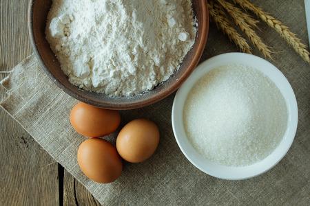 loamy: Flour, sugar and eggs top view selective focus Stock Photo