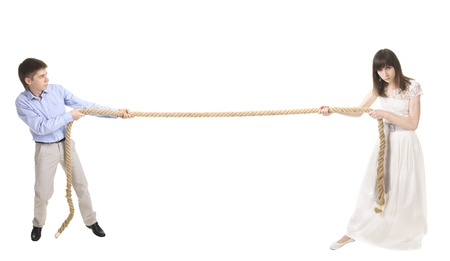 man and woman keep pulling the rope photo