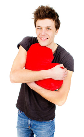 an image of cute man holding a toy heart photo