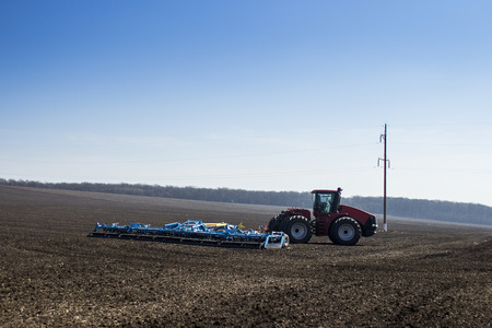 sow: an image of tractor in the field sow Stock Photo