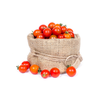 basket: an image of organic tomatoes in basket Stock Photo