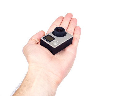 cam gear: Hand holding small action camera