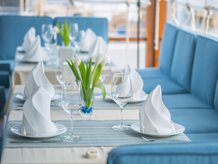 Interior design of a beautiful restaurant in a marine style. Stock Photo
