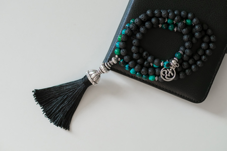 philosophic: Beautiful handmade lava mala gems beads with tassel for mantras and meditation Stock Photo