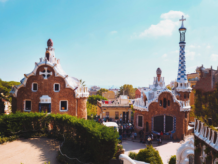 Park Guell in Barcelona. View to entrace houses with mosaics on foreground Stock Photo
