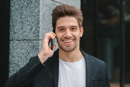 Close up portrait of businessman have conversation using mobile phone. Business guy in formal suit gladly talks with colleague. Office employee, wage worker, weekdays concept. Banco de Imagens - 110543537