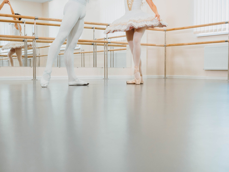 Legs close up. Rehearsal in the ballet hall or studio with minimalism interior. Young professional sensual dancer's couple in beautiful costume dancing together. Copy space Banco de Imagens - 111486427
