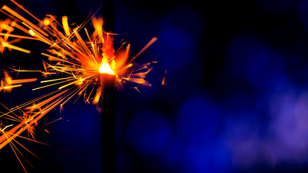 Bright sparks slowly fly from bright burning bengal light stick. Bengal fire macro view. Abstract holiday background. New 2019 year mood. Merry Christmas. Copy space. Banco de Imagens - 113058884