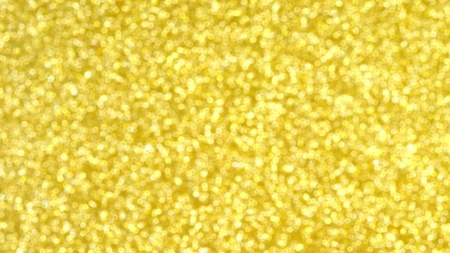 Golden background. Gold shining sparkles underwater, beautiful abstract texture.