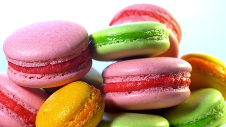 Colorful macaroons. Cooking, food and baking, pastry shop concept. French macarons - meringue cookies with ganache or buttercream filling Banco de Imagens