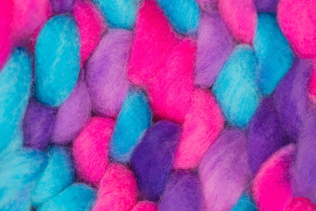 Colorful merino wool texture close up. Knitted background