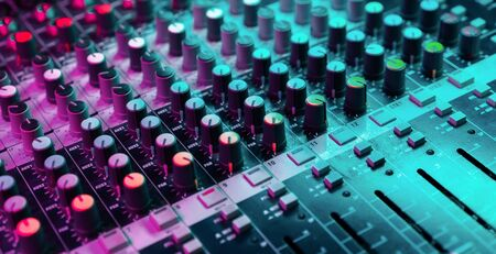 Close up of sound mixing console. Details of sound engineer room. Neon light