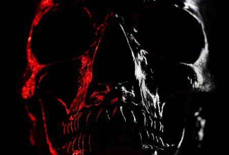 Shining skull head on dark background with neon red light. Halloween celebration, glamour, style concept. fear and horror. Stok Fotoğraf
