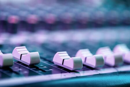 Close up of faders on sound mixing console. Details of sound engineer room. Stok Fotoğraf
