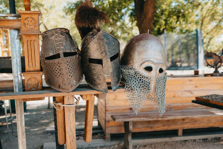 Exhibition of Medieval knightly armor in ancient fortress. Swords, shields and other weapons.