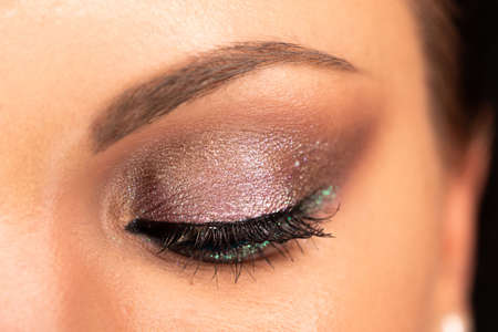 Close up of woman face with amazing make-up, eye with glitter shadows. Art, beauty industry, cosmetics concept. Zdjęcie Seryjne