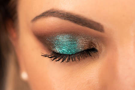 Close up of woman face with amazing make-up, eye with glitter shadows. Art, beauty industry, cosmetics concept.