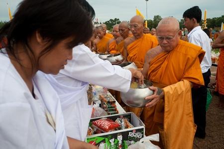 nakhon pathom: Phutthamonthon, Nakhon Pathom, Thailand - July 15, 2011 - Thai people give alms to a old Buddhist monk at  Phutthamonthon on Asarnha Bucha Day