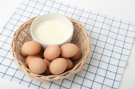 albumin: Dried albumin and eggs on white tablecloth  Stock Photo
