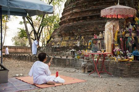candlelit: WatMahaeyong, Ayutthaya, Thailand - February 22,2016 - Buddhist pray at WatMahaeyong on Magha Puja Day.