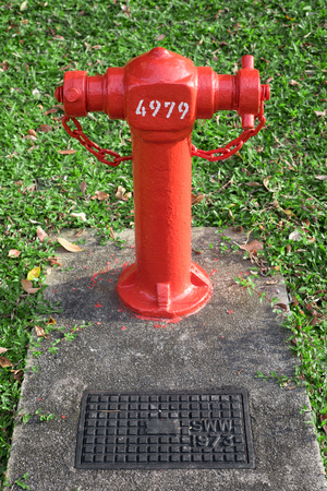 Fire hydrant on cement base Stock Photo