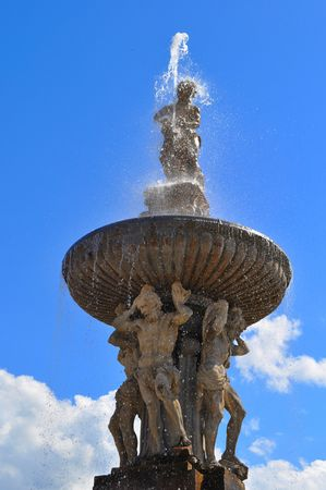 big fountain with statue in Budweis
