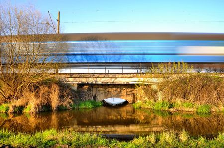 Blur train speeding through nature photo