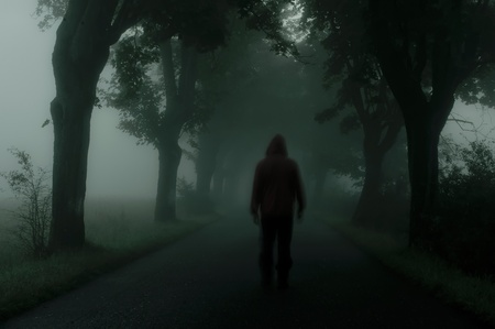 horrors: silhouette of man in dark atmosphere Stock Photo