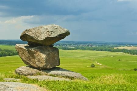 monolith: old big stones on meadow