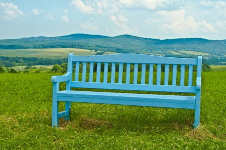 nice blue bench in mountains photo