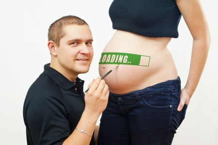 man painting on pregnant woman photo