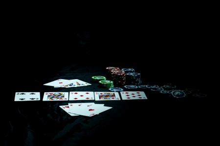 poker cards on dark background photo