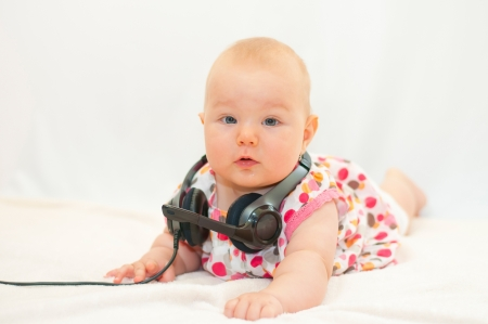 lying little baby with headset photo