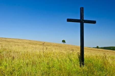 big cross on summery meadow Standard-Bild