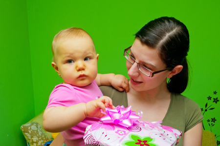 Mom giving a present a child photo
