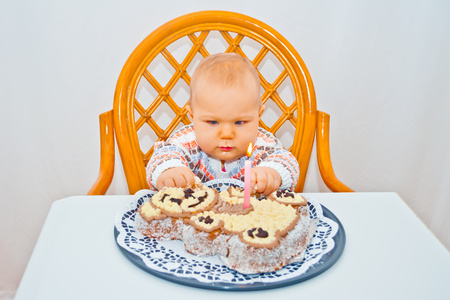 little baby and birthday cake photo