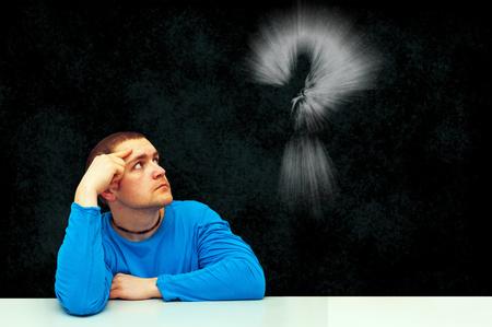 thinking symbol of young man photo