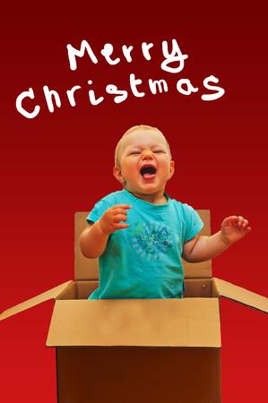 baby open present: little baby in open present box Stock Photo