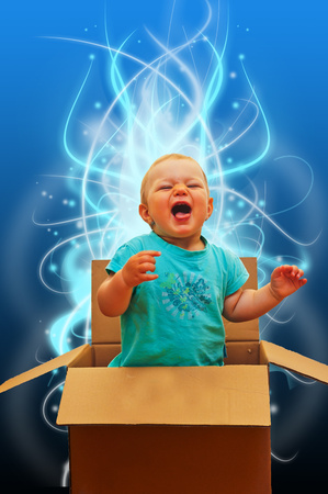 little baby in open present box Standard-Bild