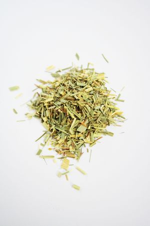 lemon grass: Pile of dried lemongrass (Cymbopogon). This herb is widely used as a spice in Thai, Vietnamese, Sri Lankan and also Caribbean cuisine. It can also be used as a tea. It has a fresh taste, like lemon.