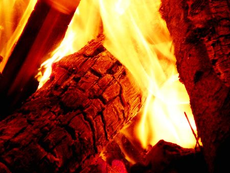 Close-up view of a campfire. The log has turned to charcoal already. Stock Photo - 640473