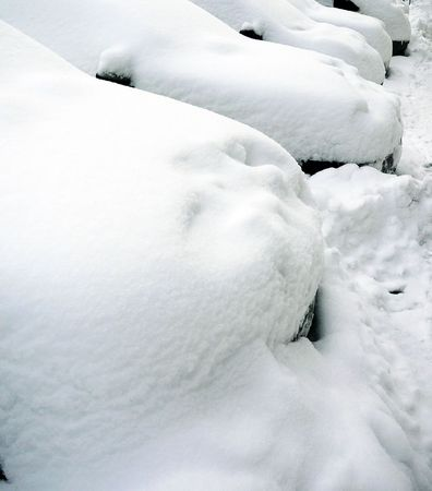 Parking cars, covered with a thick layer of snow. Stock Photo