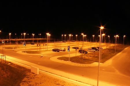 An almost empty parking lot at night. Picture taken in Germany.