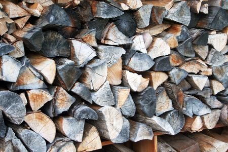 Pile of logs, piled up for winter. picture taken on a house in the bavarian alps.  Stock Photo - 803330