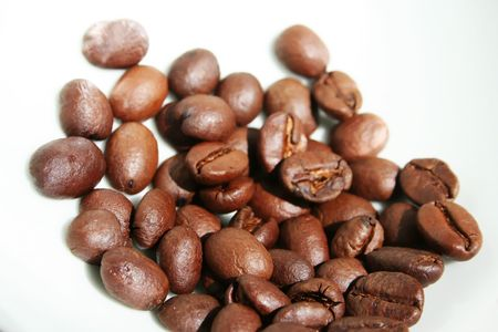 recognize: Pile of roasted coffee beans. Its African coffee, in case you recognize it.